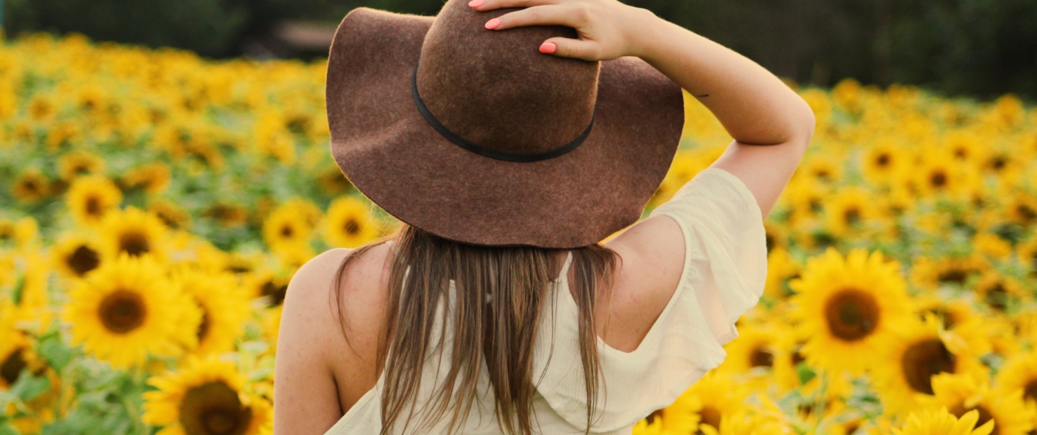 Natural Living Woman in Field of Sunflowers