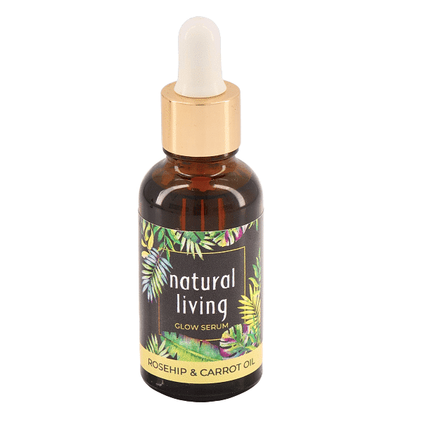 Natural Living Rosehip and Carrot Seed Oil Glow Serum in a 30ml amber bottle